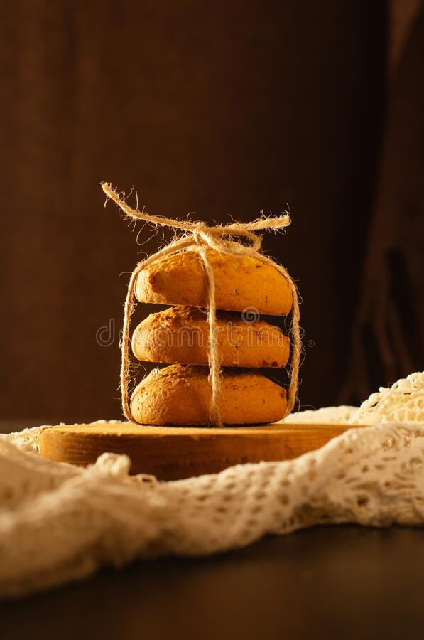 Oatmeal cookies on the table, the lace tablecloth vintage style stock photo