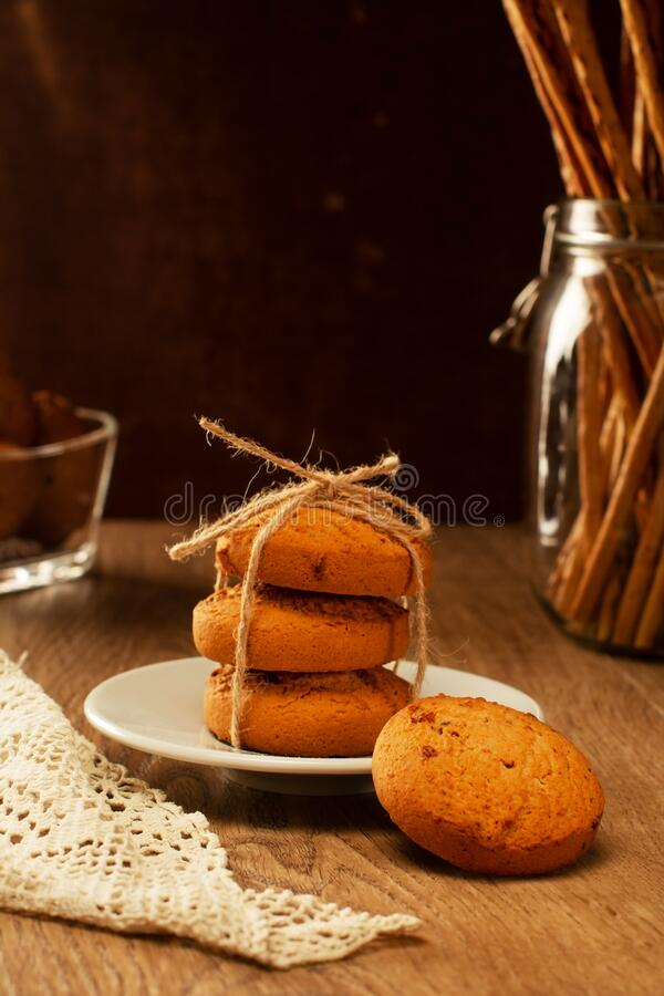 Oatmeal cookies on the table, the lace tablecloth vintage style royalty free stock photo