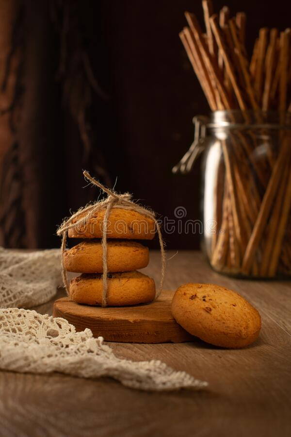 Oatmeal cookies on the table, the lace tablecloth vintage style stock photos