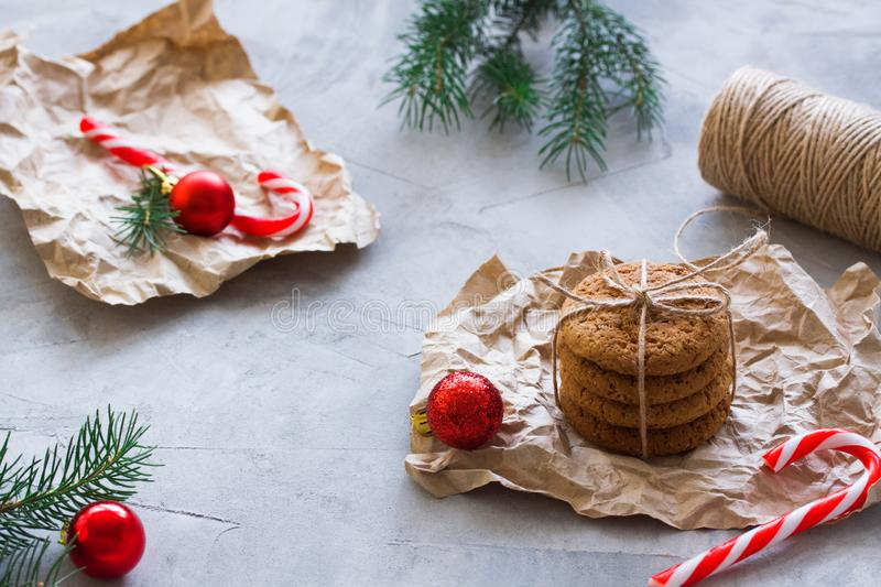 Oatmeal cookies tied with string in craft paper Christmas concept royalty free stock photography