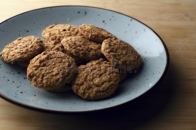 Oatmeal cookies on white background. Healthy oatmeal and wheat cookies on a solid white background in two groups, the first of three cookies and the second of royalty free stock image