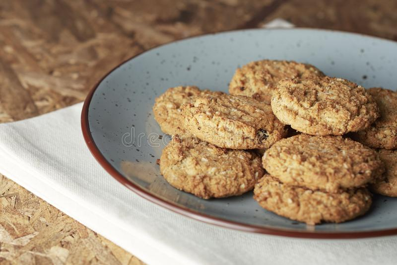 Oatmeal cookies on white background. Healthy oatmeal and wheat cookies on a solid white background in two groups, the first of three cookies and the second of stock images