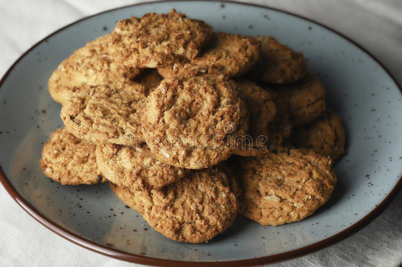 Oatmeal cookies on white background. Healthy oatmeal and wheat cookies on a solid white background in two groups, the first of three cookies and the second of stock image