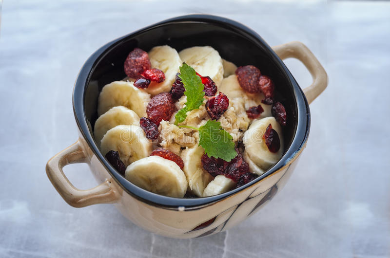 Oatmeal with dried fruits and banana stock photography