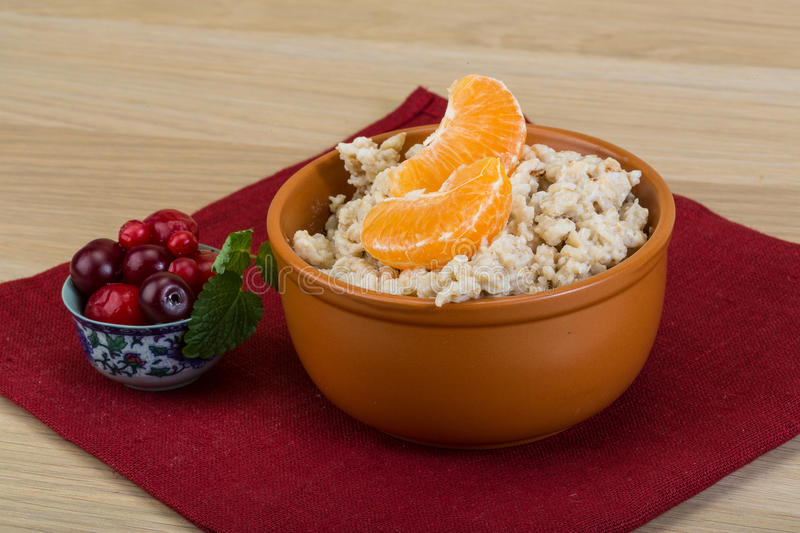 Oatmeal. With fresh berries in the bowl royalty free stock image