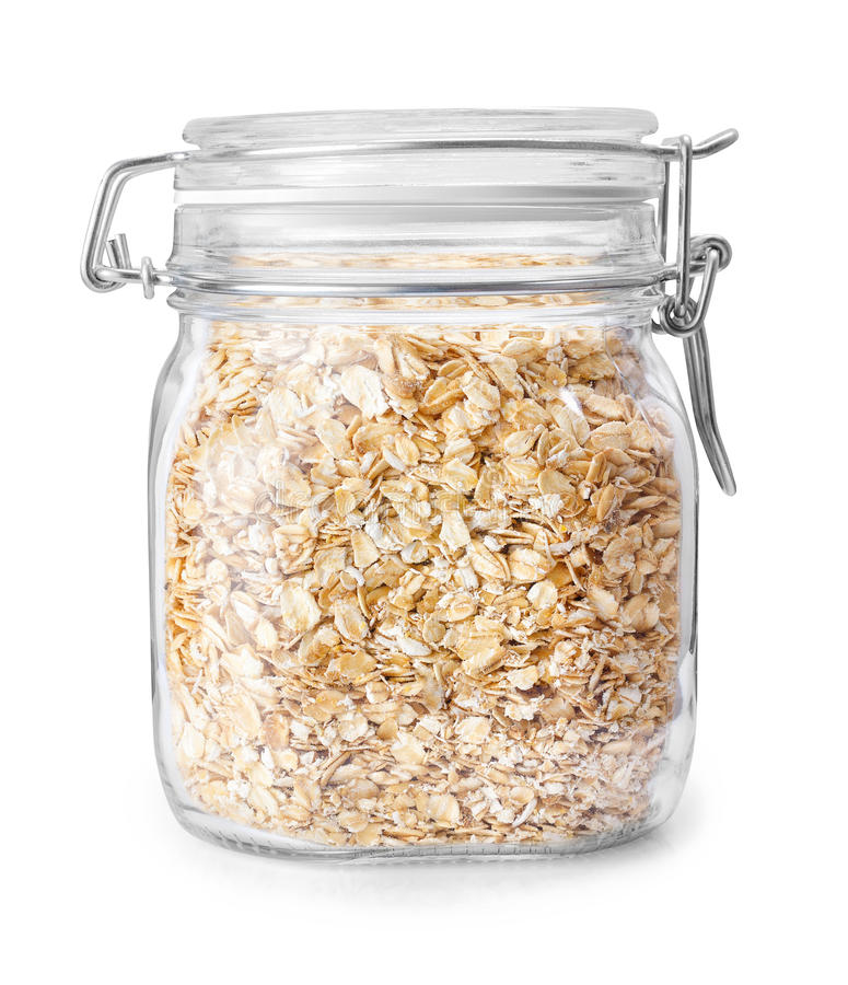 Oatmeal in glass jar isolated on white stock photography