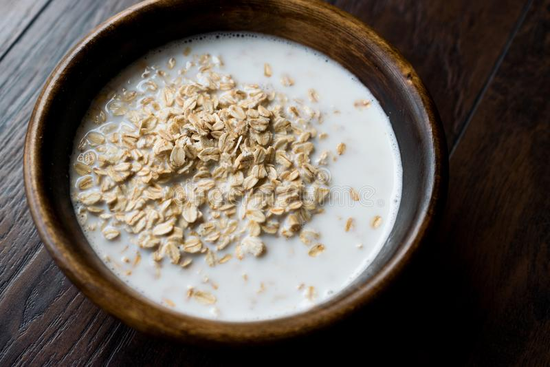 Oatmeal with Milk in Wooden Bowl / Plain Porridge royalty free stock photo