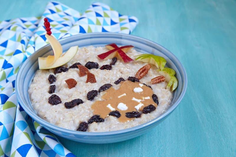 Oatmeal porridge decorated with treasure map stock photos