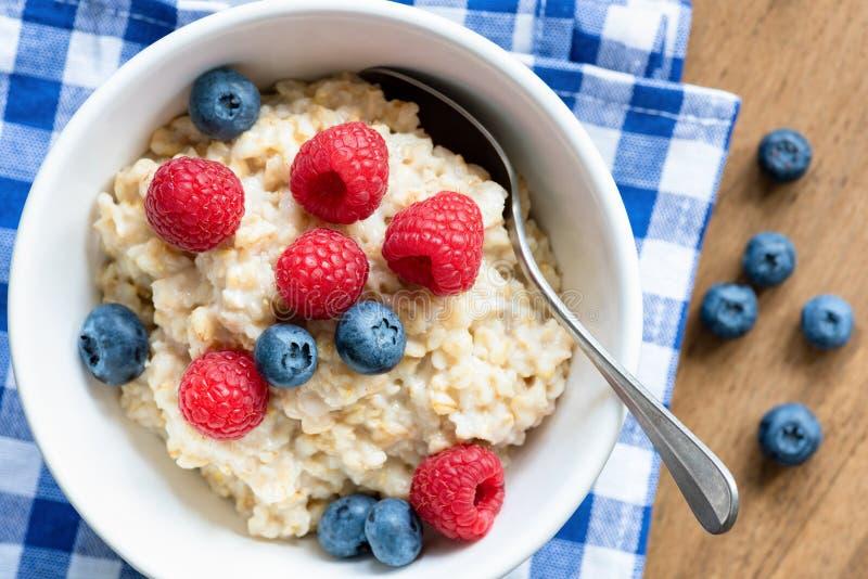 Oatmeal porridge with fresh berries, closeup view stock photography