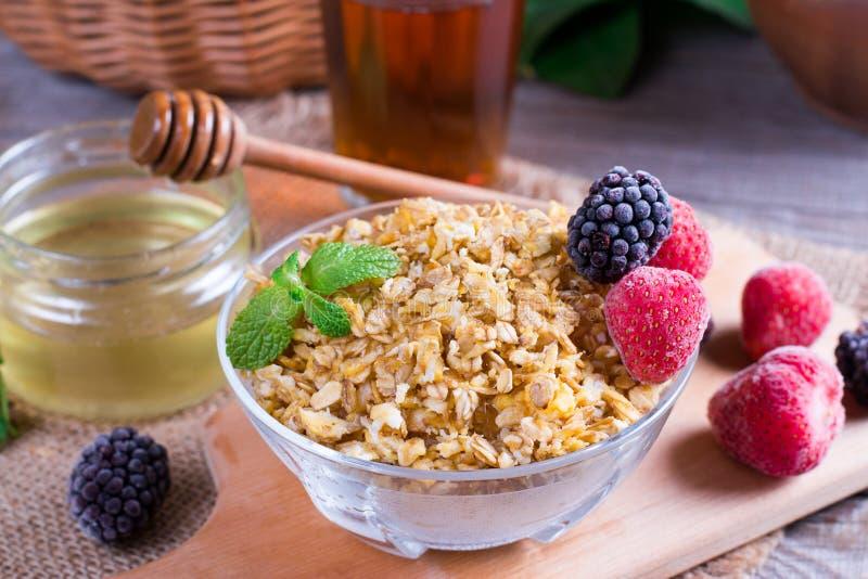 Oatmeal porridge with fresh strawberries and blackberries. Healthy breakfast, healthy eating, vegan food concept. royalty free stock photography