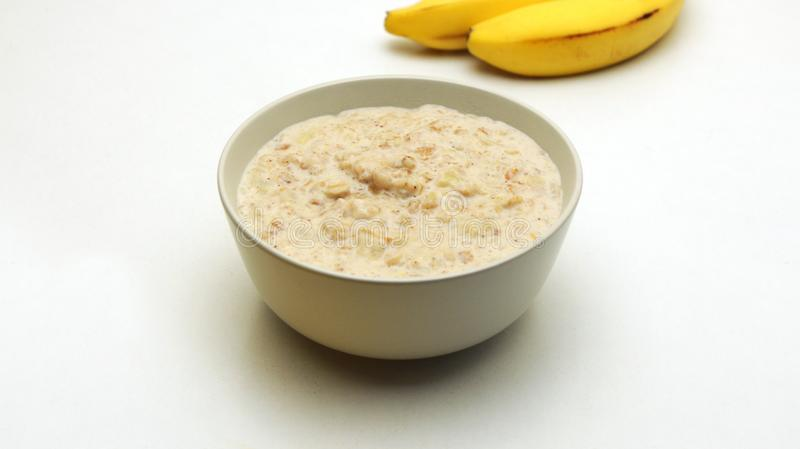 Oatmeal Porridge in a Glass Bowl on a White Background. royalty free stock photography