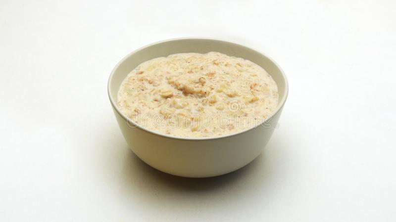 Oatmeal Porridge in a Glass Bowl on a White Background. royalty free stock image