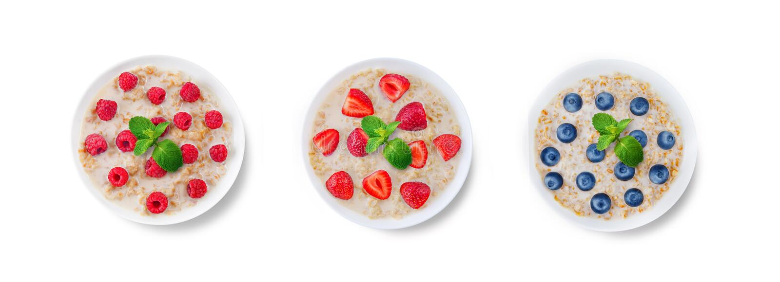 Oatmeal porridge with milk and fresh on a white isolated background royalty free stock photography