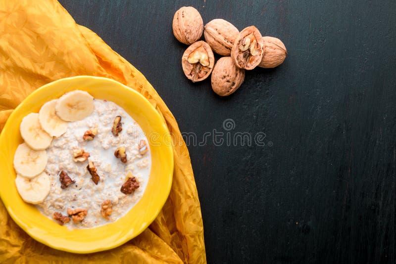 Oatmeal with walnuts and banana stock image