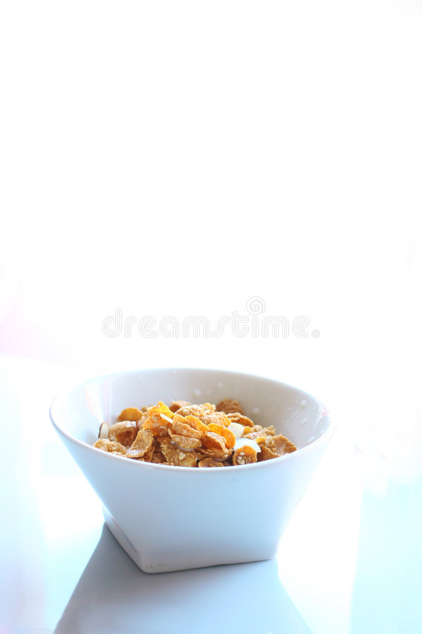 Oats and almond cereal. White bowl with oats and almond cereal on a white background stock images