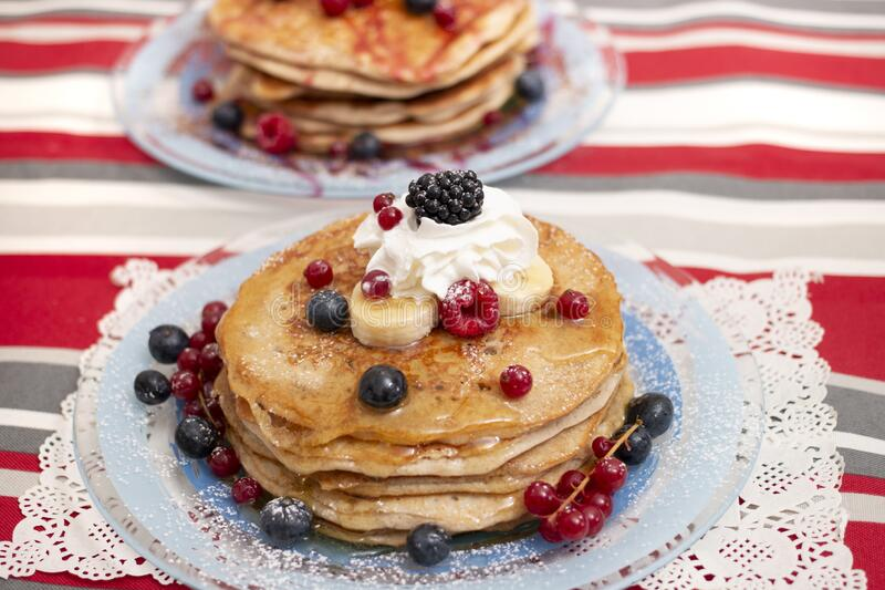 Oats and banana pancakes with berries stock images