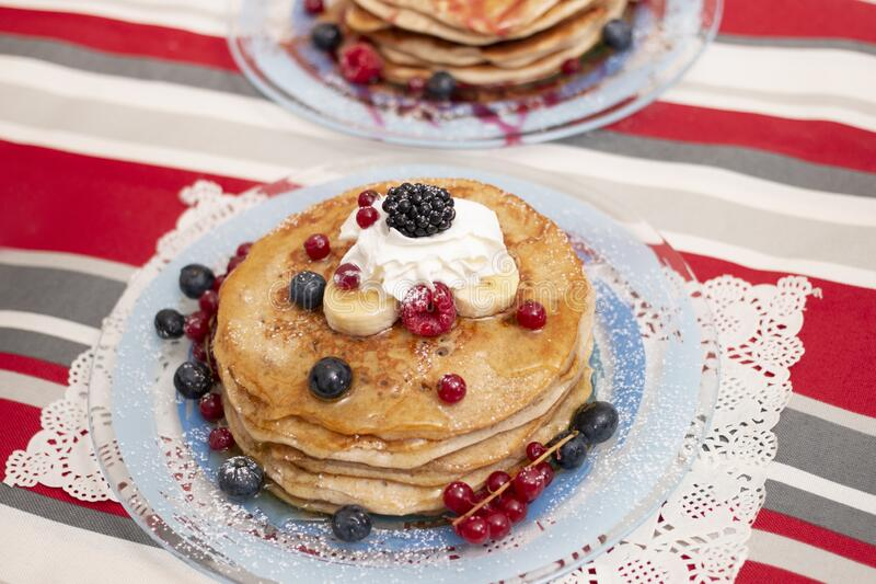 Oats and banana pancakes with berries royalty free stock photography
