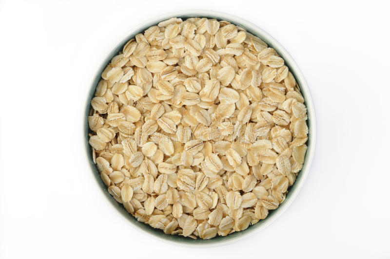 Oats in bowl stock photos