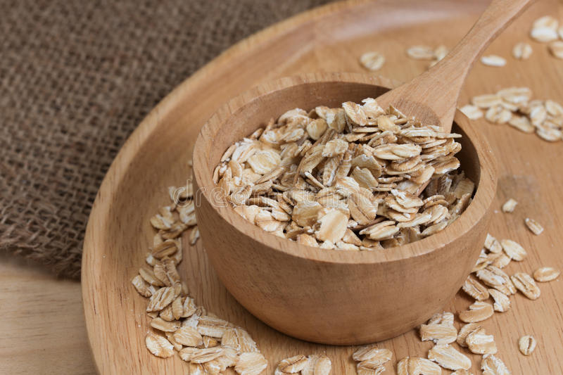 Download Oats In Bowl On Wooden Plate Stock Photo - Image: 83707492