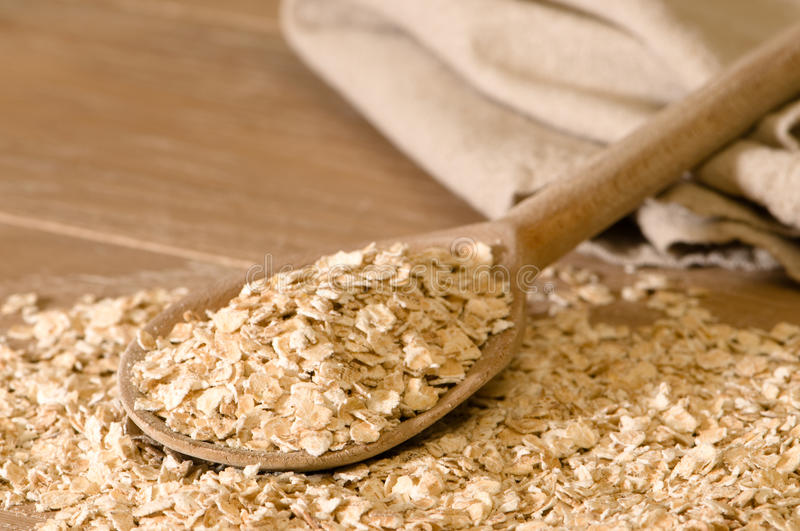 Download Oats On Rustic Spoon stock image. Image of rustic, flakes - 12989285