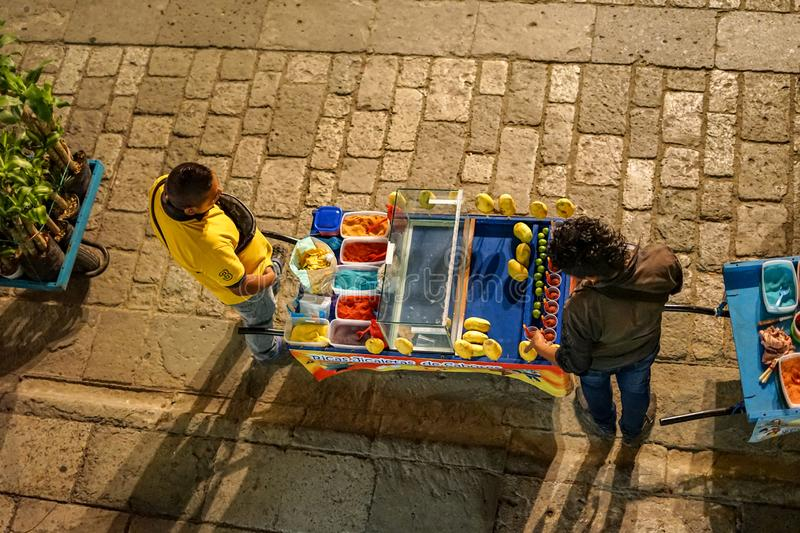 Street market at Oaxaca, Mexico. Oaxaca city in Mexico is famous for its modern art production, crafts and delicious food. You can find fresh food at every royalty free stock image