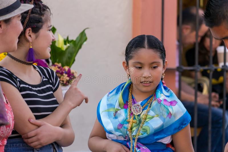 Young girl in traditional costume. Oaxaca, in Mexico, is famous for its modern art galleries and traditional events. Here, a young girl prepares herself for a royalty free stock photo