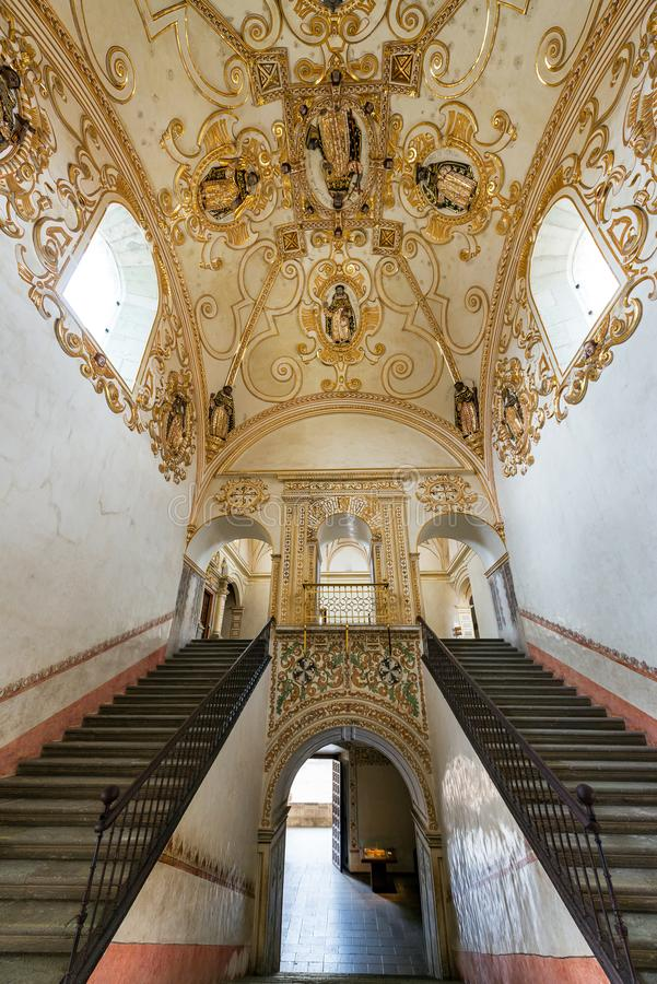 Stairs and Ornate Ceiling. OAXACA, MEXICO - MARCH 4: Stairs and ornate ceiling in a former monastery in Oaxaca, Mexico on March 4, 2017 royalty free stock photography