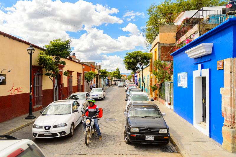 Architecture of Oaxaca. OAXACA, MEXICO - OCT 31, 2016: Small colorful houses on the typical street of Oaxaca de Juarez, Mexico. The name of the town is derived royalty free stock photos