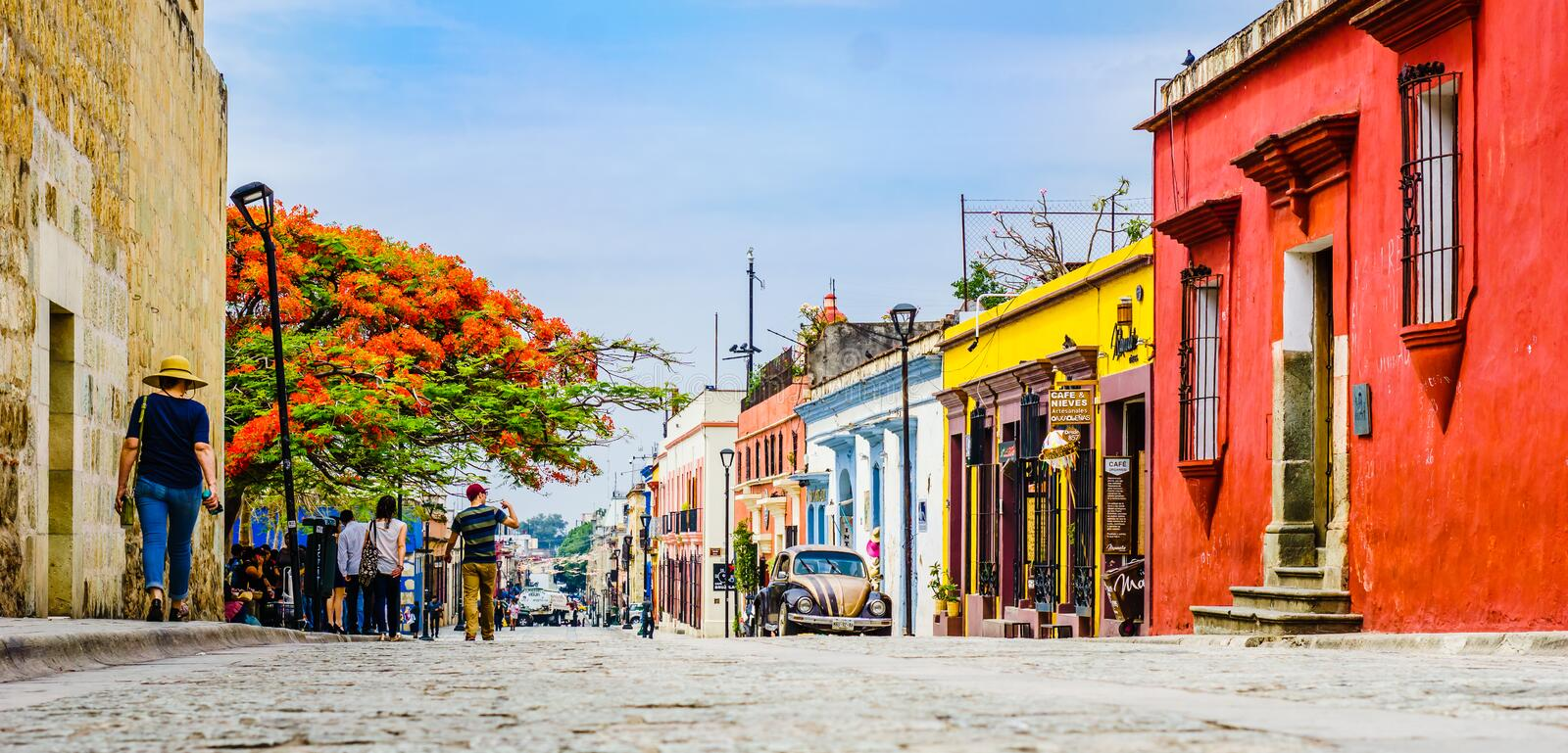 Oaxaca, Mexico on 24th April 2016: Street with Colorful colonial buildings in th eold town with a group of people stock photo