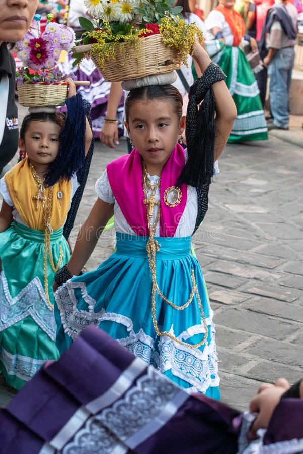 Little girls dressed with traditional clothes stock images