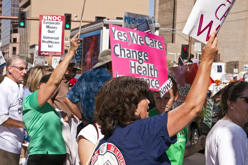 Obama Supporters Demonstrate in Street. Phoenix, Arizona, USA. While President Barack Obama spoke at the Veterans of Foreign Wars (VFW) national convention in royalty free stock photo