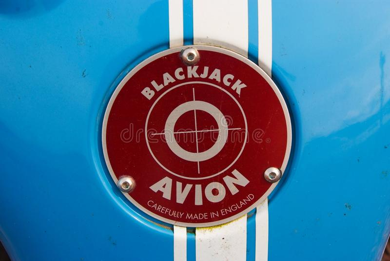 Oban, United Kingdom - February 20, 2010: blackjack avion car badge. Red badge on blue metal background. Car name and stock image