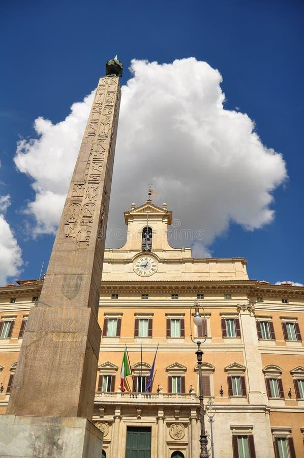 Obelisk with Egyptian symbols stock images
