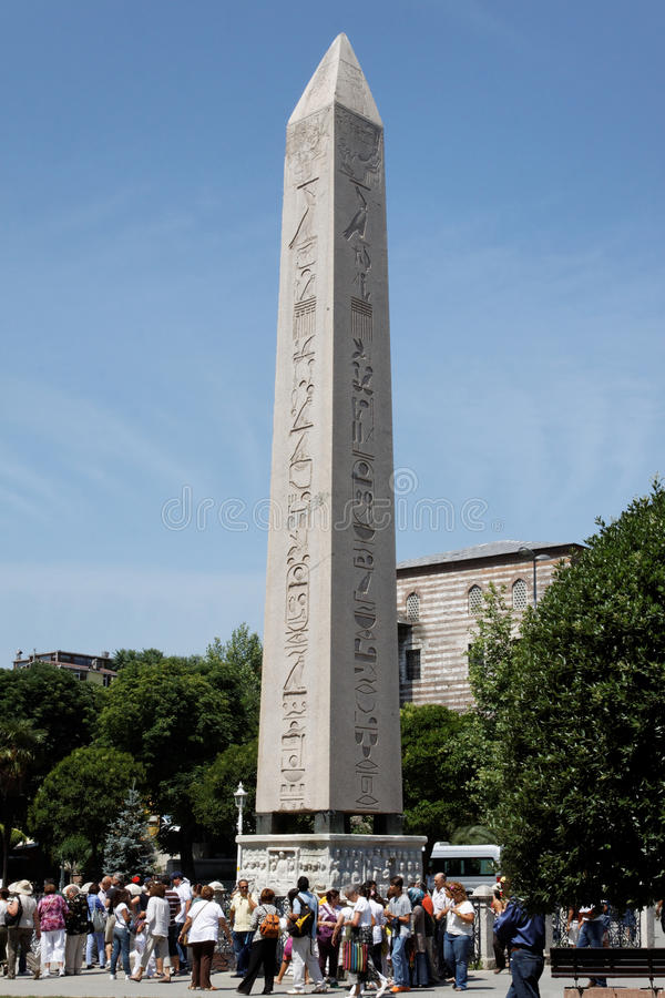 The Obelisk of Istanbul. Tourists around the egiptian obelisk of Tutmosis III at the hippodrome of Istanbul, Turkey stock image