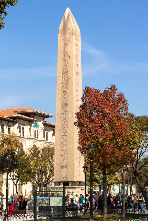 The Obelisk of Istanbul. Tourists around the egiptian obelisk of Tutmosis III at the hippodrome of Istanbul, Turkey stock photos