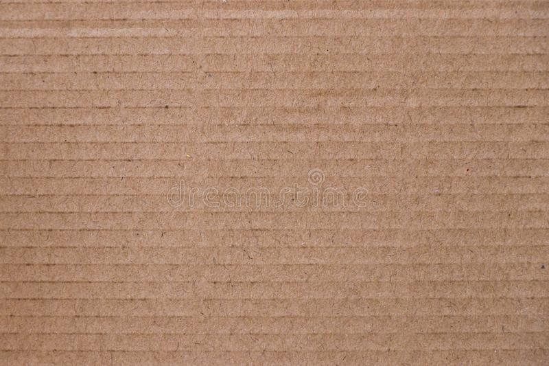 Oben geschlossen vom braunen Kraftpapierbeschaffenheitshintergrund stockbild