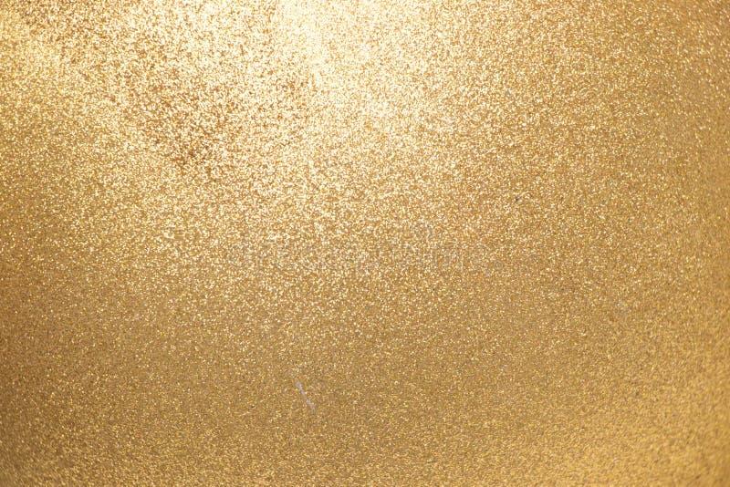 Oben geschlossen vom metallischen Goldfunkeln-Beschaffenheitshintergrund stockfotos