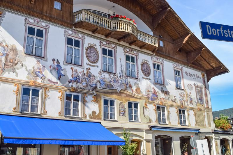 OBERAMMERGAU, GERMANY - OKTOBER 09, 2018: Painted medieval painting on the facade of an old house with flowers stock photos