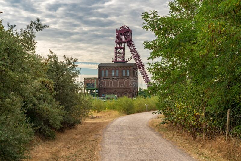 Mining tower in Oberhausen, North Rhine-Westfalia, Germany. Oberhausen, North Rhine-Westfalia, Germany - July 30, 2018: Clouds over a historic mining tower stock images