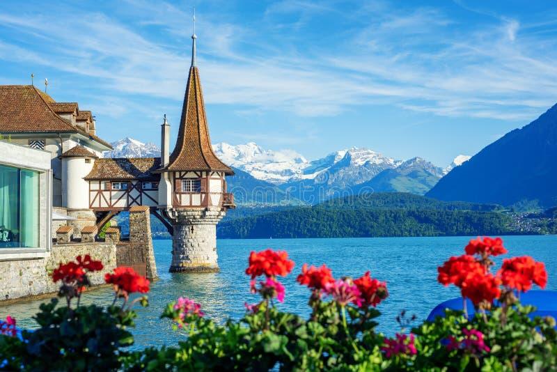 Oberhofen castle on Lake Thun, Switzerland, Alps mountains royalty free stock photography