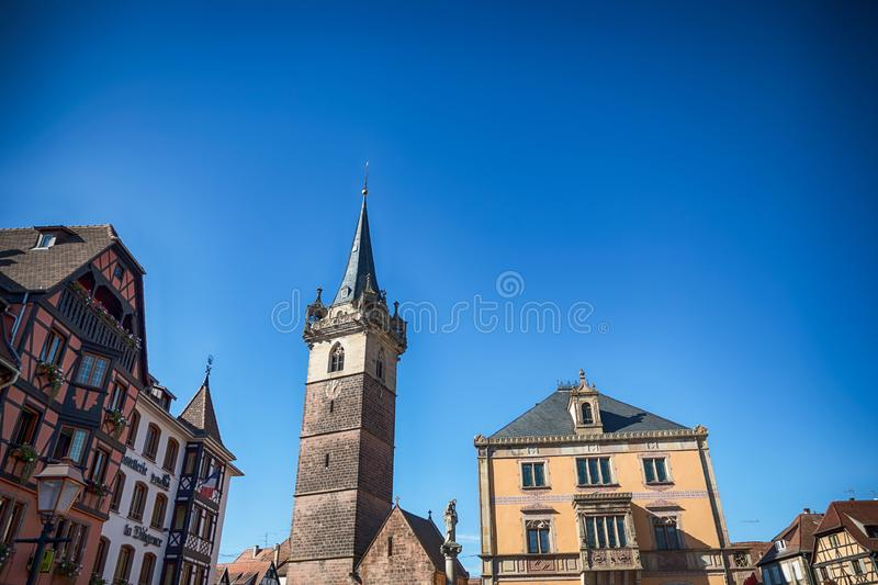 Obernai, France. October 14, 2018. Main square in Obernai with Kapellturm tower. And blue sky royalty free stock images