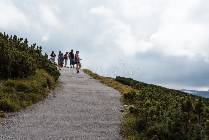 Scenic view of path in the mountain with people hiking on backgr royalty free stock photo