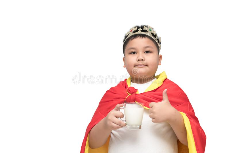 Obese boy is showing his thumb up with milk stock images