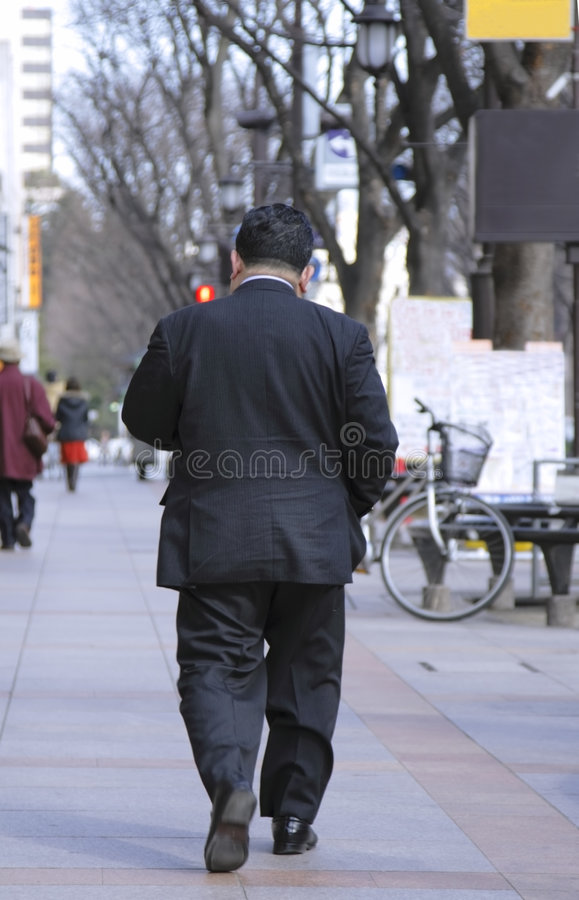 Obese businessman stock images