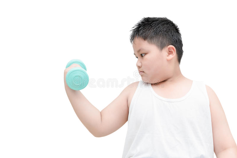 Obese fat boy is doing exercises with dumbbells stock images