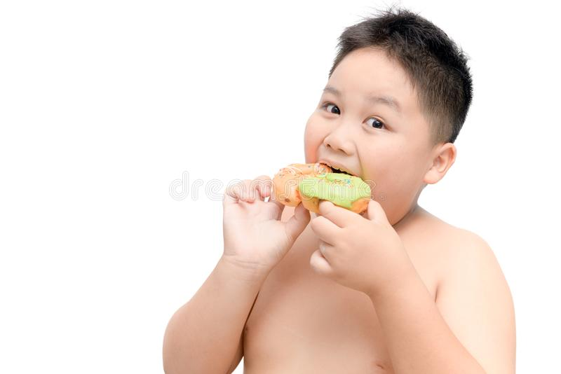 Obese fat boy is eating donut isolated stock photos