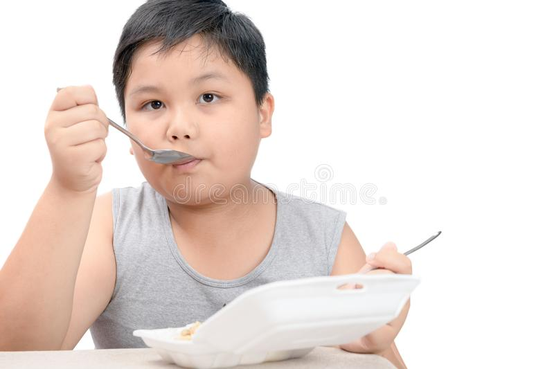 Obese fat boy eating fried rice in foam box isolated stock images