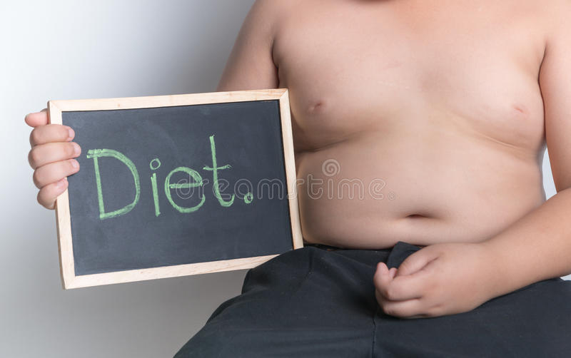 Obese fat boy holding blackboard stock image