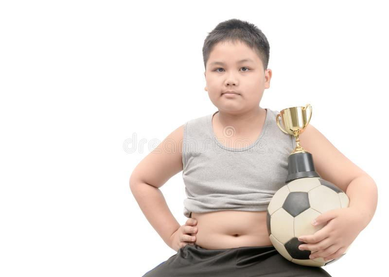 Obese fat boy holding football and trophy stock photos