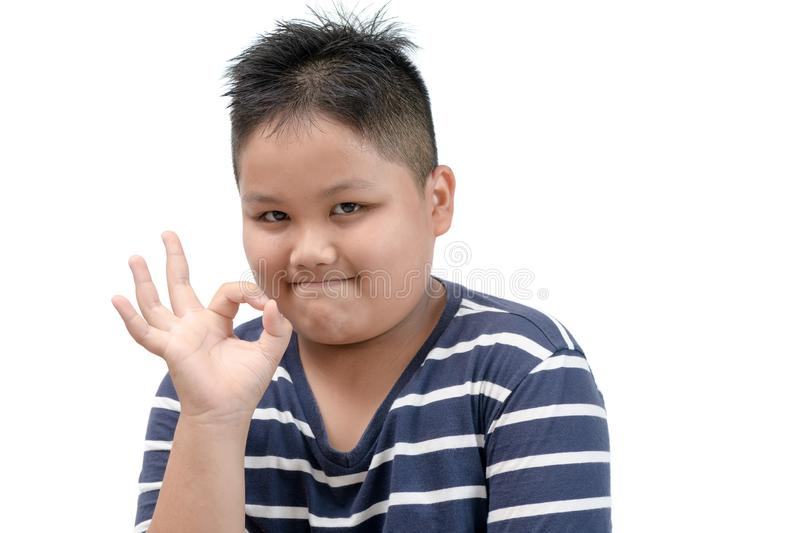 Obese fat boy showing OK sign isolated stock image